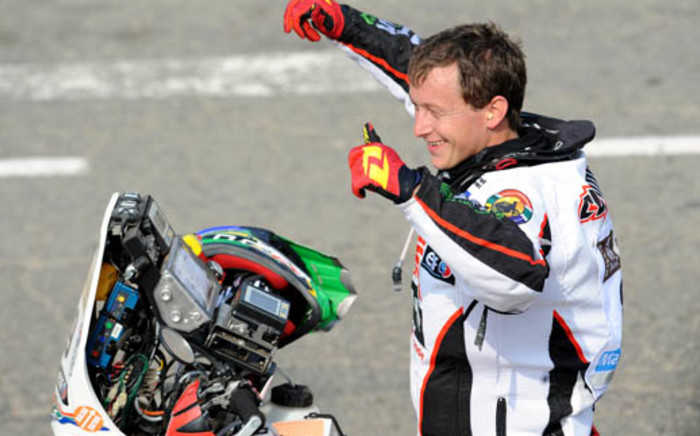 South African Motorcyclist Brett Cummings gives the thumbs up ahead of the start of Dakar 2013. Picture: AFP.