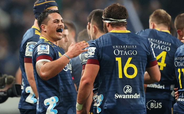 FILE: Highlanders' Daniel Lienert-Brown (L) celebrates victory with teammate Liam Coltman during the Super Rugby match between the Otago Highlanders and Waikato Chiefs at Forsyth Barr Stadium in Dunedin on 13 June 2020. Picture: AFP