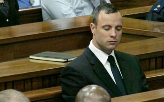 Oscar Pistorius closes his eye as he sits in the dock after testifying at the High Court in Pretoria on 15 April 2014.