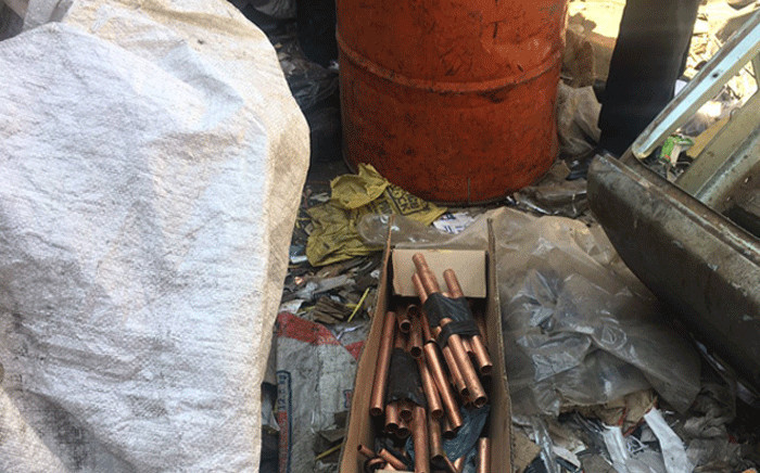 Officials discovered plastic bags filled with copper cables at the Dirisanang Cash for Scrap dealership in Industria West. Picture: Mia Lindeque/EWN.