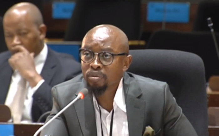 A screengrab of former executive head of IT security at the Public Investment Corporation Simphiwe Mayisela testifying at the PIC inquiry on 5 March 2019.
