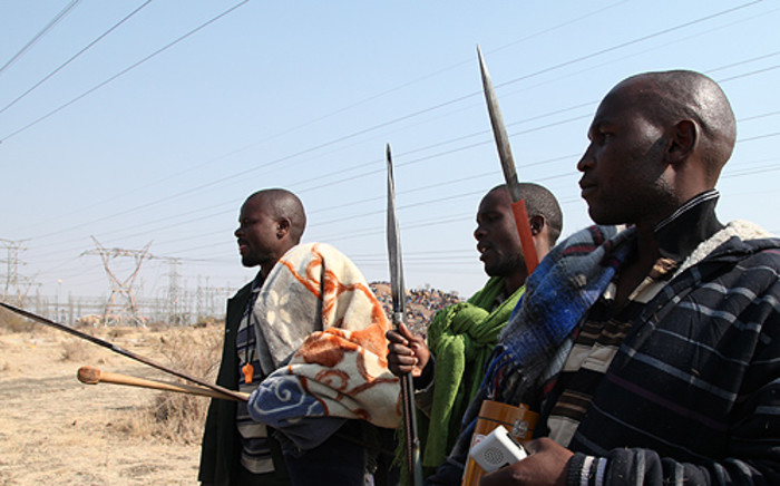 Protesters from Lonmin's Marikana Mine carried traditional weapons as they demonstrated during August, demanding better wages. Picture: Taurai Maduna/EWN.