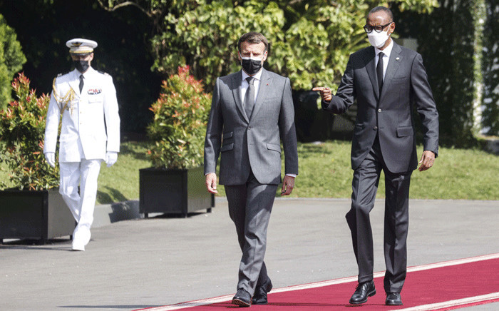 Rwandan President Paul Kagame (R) receives French President Emmanuel Macron at the Presidential Palace in Kigali on May 27, 2021. French President Emmanuel Macron arrived in Rwanda on May 27, 2021, for a highly symbolic visit aimed at moving on from three decades of diplomatic tensions over France's role in the 1994 genocide in the country. Picture: Ludovic Marin / AFP