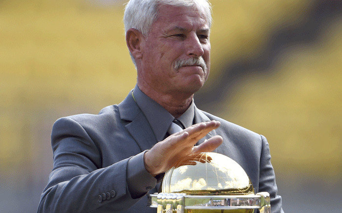 A file photo taken on 1 March 2015, shows New Zealand cricket legend Richard Hadlee with the Cricket World Cup trophy before the start of the 2015 Cricket World Cup Group A match between England and Sri Lanka in Wellington. Picture: AFP.