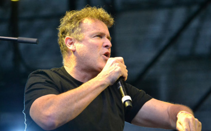 South African musician, Johnny Clegg sings in honour of Nelson Mandela during his memorial service at the Cape Town Stadium on 11 December 2013. Picture: EWN.