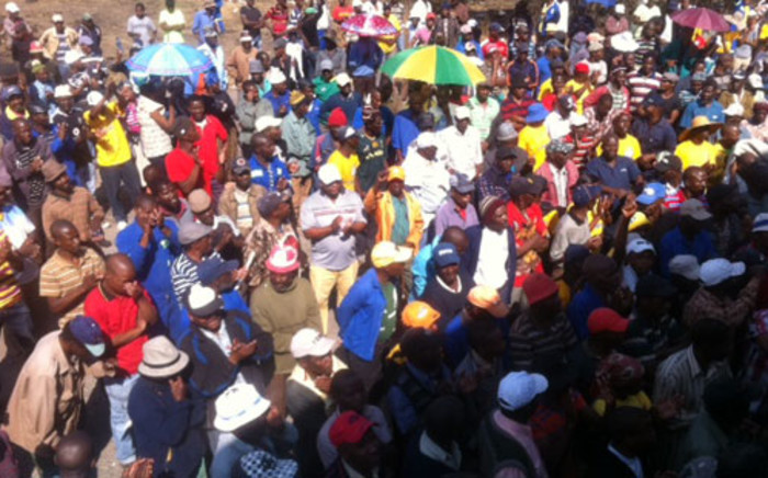 Workers from the Aurora Mine wait for Julius Malema to arrive. Picture: Taurai Maduna/EWN.