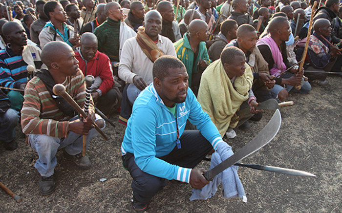 Protesters await instruction from their leaders, at Lonmin's Marikana mine. Picture: Taurai Maduna/EWN