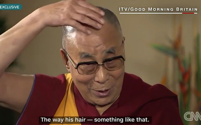 This screengrab shows the Dalai Lama impersonating Donald Trump on the Good Morning Britain show. Picture: CNN/YouTube.