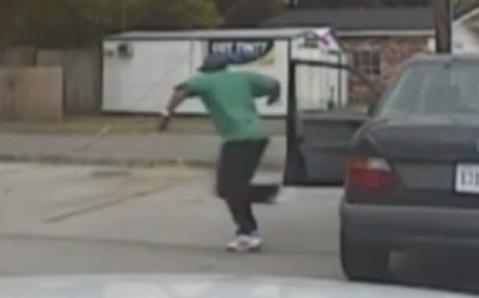 A screengrab footage shows a black man fleeing the traffic stop after being pulled over by police officer before being gunned down moments later.