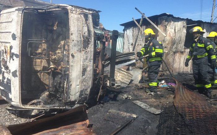 A truck and two shacks have been torched during a protest along Mew Way in Khayelitsha. Picture: Lauren Isaacs/EWN.