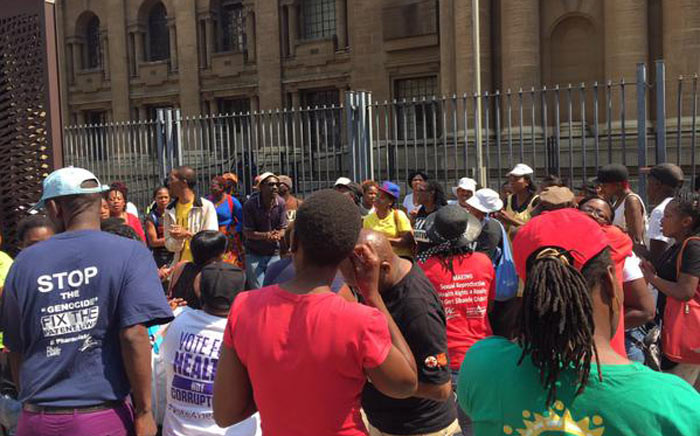 FILE: Members of the Treatment Action Campaign (TAC) & Sonke Gender Justice protesting outside court to show their support for ex-miners seeking compensation for contracting silicosis while working underground. Picture: Gia Nicolaides/EWN