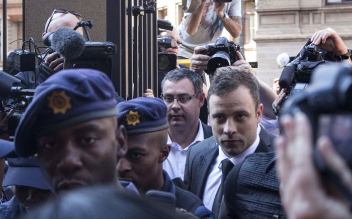 Oscar Pistorius arriving under heavy police guard at the High Court in Pretoria ahead of judgment in his murder trial on 12 September 2014. Picture: Christa Eybers/EWN.