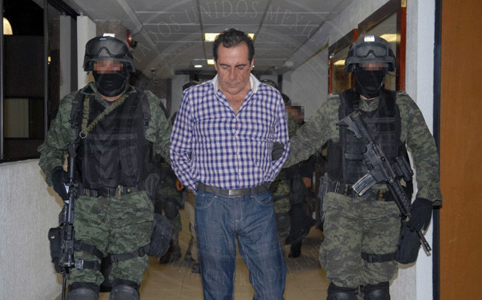 """FILE: A handout picture shows Hector Beltran Leyva, leader of the Beltran Leyva's drug cartel, during a press conference at the headquarters of the General Attorney in Mexico City, on 1 October, 2014 after Beltran Leyva, aka the """"H"""", was arrested in San Miguel de Allende, Guanajuato State, Mexico. Picture: AFP"""