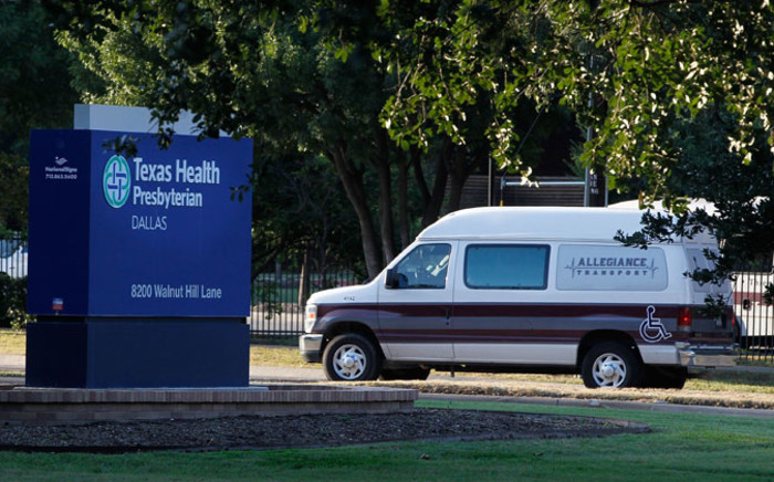A medical transport van moves past Texas Health Presbyterian Hospital Dallas where a patient has been diagnosed with the Ebola virus on 30 September, 2014 in Dallas, Texas. Picture: AFP.