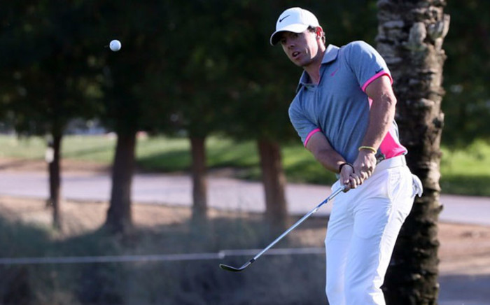 Rory McIlroy of Northern Ireland plays a shot during the third round of the 2015 Omega Dubai Desert Classic on January 31, 2015 in Dubai, United Arab Emirates. Picture: AFP
