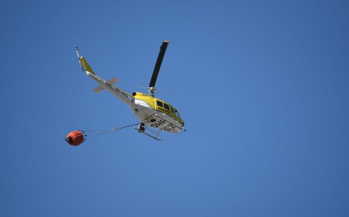 FILE: A helicopter works to put out a fire at Signal Hill. Picture: Working on Fire.