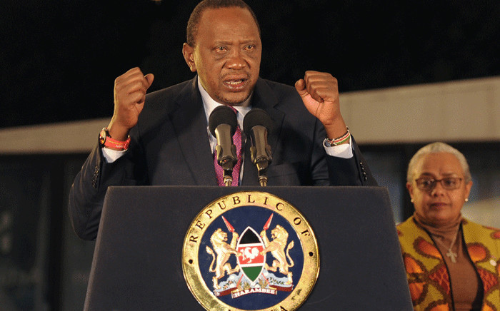 Kenya's President Uhuru Kenyatta speaks following the Electoral Commission's official announcement of the election results on 11 August 2017 at the Bomas of Kenya in Langata. Picture: AFP