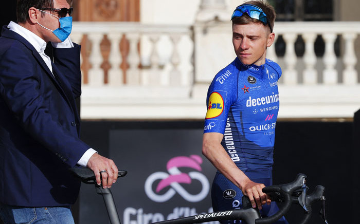Belgian rider Remco Evenepoel of Deceuninck-Quick Step team arrives on stage at the Castello del Valentino (Valentine Castle) in Turin, on 6 May 2021 for the opening ceremony of the presentation of participating teams and riders, two days ahead of the departure of the Giro d'Italia 2021 cycling race. Picture: Luca Bettini/AFP
