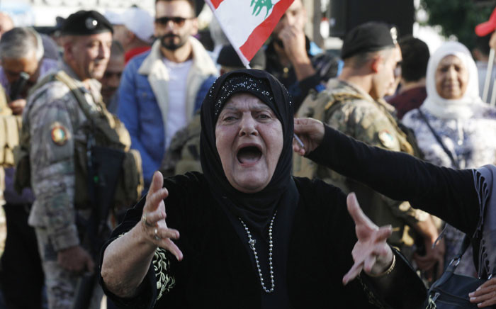 A Muslim Lebanese anti-government protester screams during continuing protests in the centre of Sidon, the capital of south Lebanon, on 3 November 2019. Picture: AFP