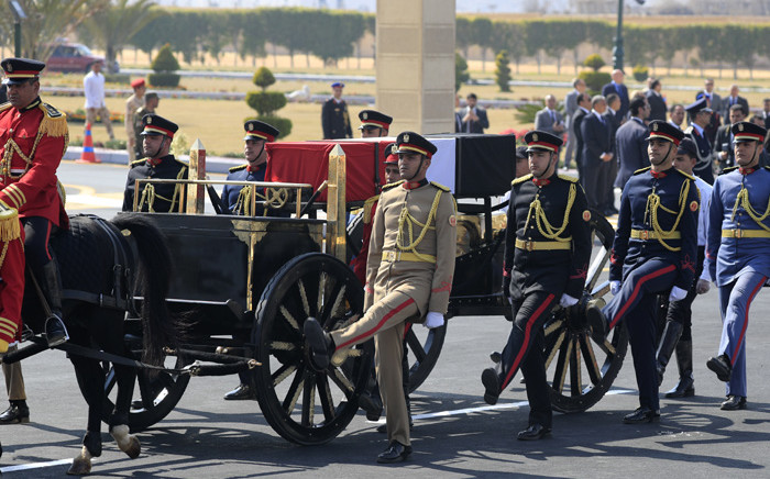 Egyptian honour guards escort the coffin of former president Hosni Mubarak during his funeral ceremony at Cairo's Mosheer Tantawy mosque in the eastern outskirts of the Egyptian capital on 26 February 2020. Picture: AFP.