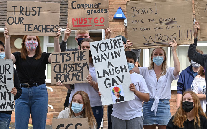 Students hold placards as they take part in a protest march from Codsall Community High School to the constituency office of Gavin Williamson, Conservative MP for South Staffordshire and Britain's current Education Secretary, in Codsall near Wolverhampton, central England on 17 August 2020, to demonstrate against the downgrading of A-level results. Picture: AFP