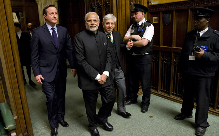 British Prime Minister David Cameron and Britains Speaker of the House of Commons John Bercow (3R)accompany Indian Prime Minister Narendra Modi (2L on a tour of The Commons Chamber inside the Houses of Parliament in central London on 12 November, 2015. Picture: AFP.