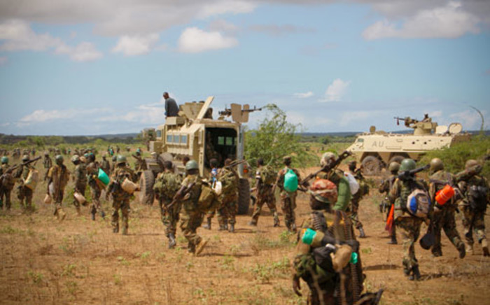 Ugandan soldiers serving with the AMISOM and troops from the Somali National Army deploy to establish a defensive position at a location south of the town of Afgoye, on May 26, 2012.Picture: AFP