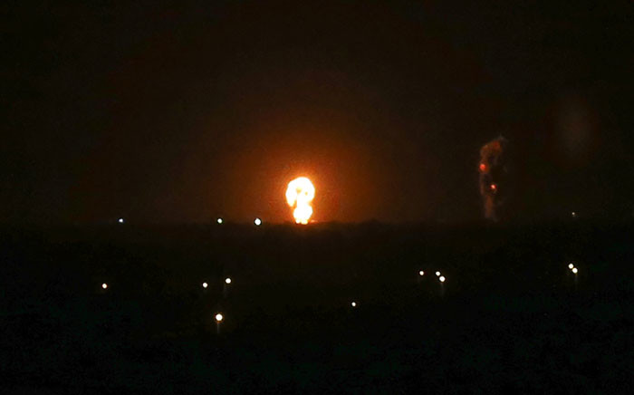A ball of fire is seen following an Israel airstrike in Khan Yunis in the southern Gaza Strip early on 27 November 2019. Picture: AFP