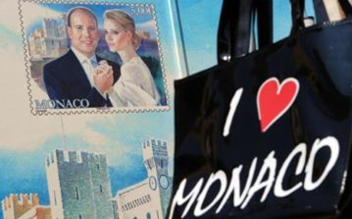 A kiosk painted with a stamp made to mark the royal wedding between Prince Albert II of Monaco and Charlene Wittstock. Picture: AFP
