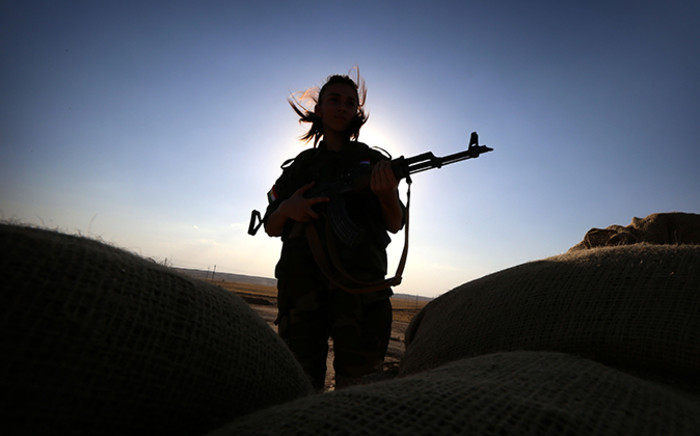 FILE: An Iranian Kurdish female member of the Freedom Party of Kurdistan (PAK) keeps a position in Dibis, some 50 kms northwest of Kirkuk, on September 15, 2014. Picture: AFP PHOTO/SAFIN HAMED