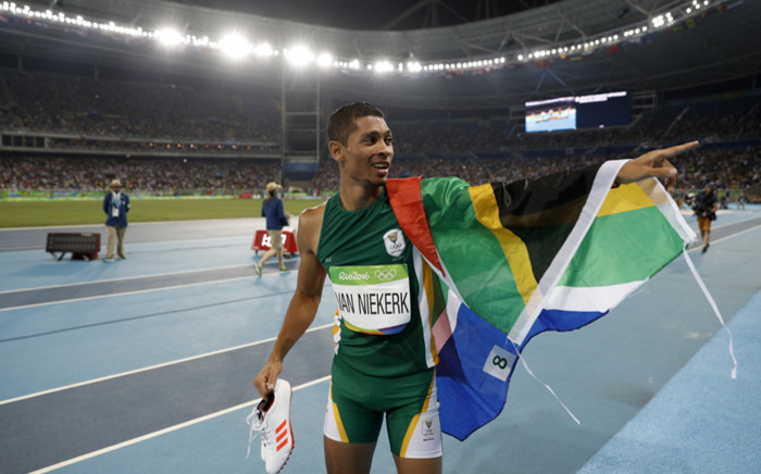 South Africa's Wayde van Niekerk celebrates winning the Men's 400m Final during the athletics event at the Rio 2016 Olympic Games at the Olympic Stadium in Rio de Janeiro on 14 August, 2016. Picture: AFP.