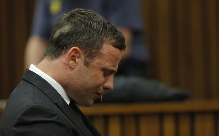 Oscar Pistorius cries while seated in the dock during judgment in his murder trial in Pretoria on 11 September 2014. Picture: Pool.