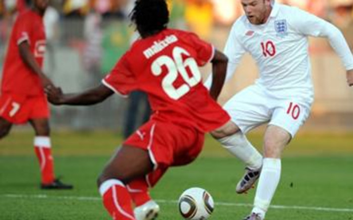 England's Wayne Rooney (R) shoots on goal during a friendly football match between Platinum Stars and England on June 7, 2010. Picture: AFP