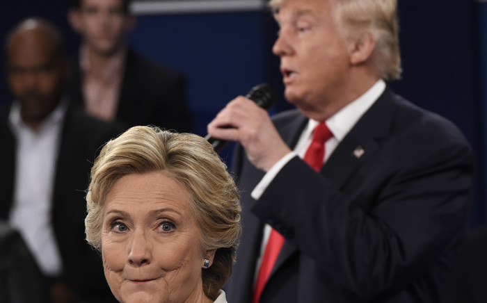 FILE: US Democratic presidential nominee Hillary Clinton and Republican presidential nominee Donald Trump during their town hall debate at Washington University in St Louis, Missouri. Picture: AFP.