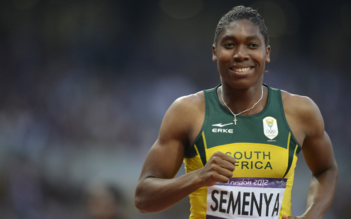 Caster Semenya smiles after the women's 800m final at the athletics event of the London 2012 Olympic Games on 11 August, 2012 in London. Picture: AFP.