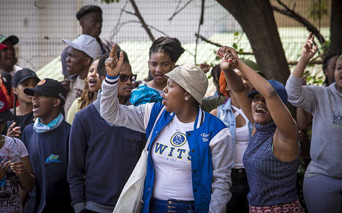 Wits students protest outside the Hillbrow Magistrates Court in support of their peers standing trial for FeesMustFall protest related charges. Picture: Thomas Holder/EWN