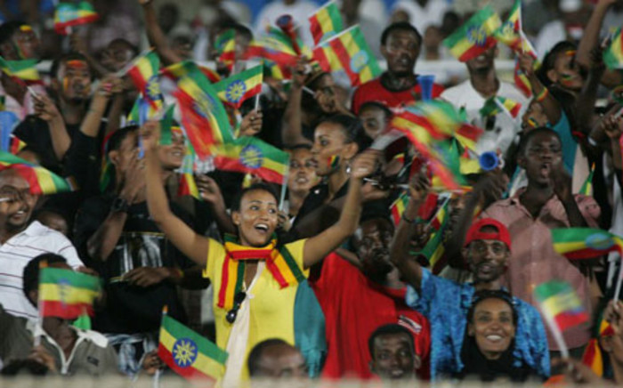 Ethiopia's national football team supporters wave flags during the 2013 African Cup of Nations second round qualifying football match between Sudan and Ethiopia on 8 September 2012. Picture: AFP