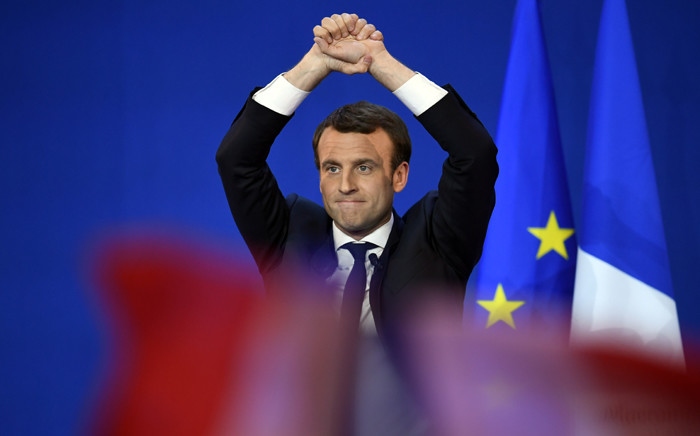 French presidential election candidate for the En Marche ! movement Emmanuel Macron gestures at the audience during a meeting at the Parc des Expositions in Paris, on 23 April, 2017, after the first round of the Presidential election. Picture: AFP