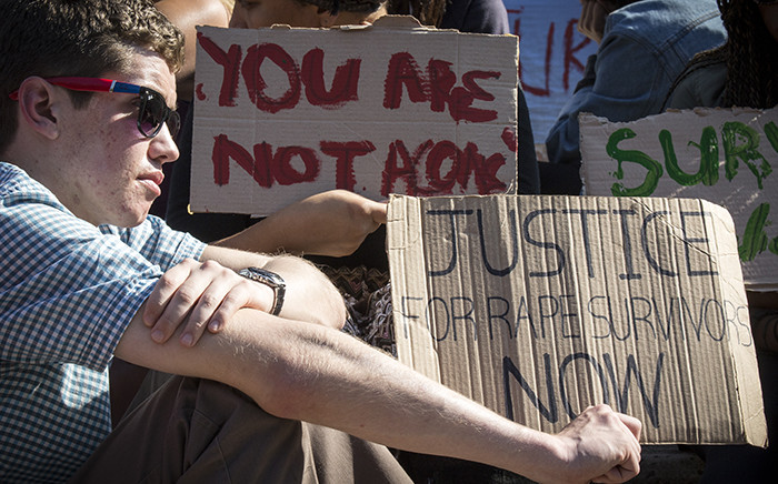 FILE: UCT students hold up posters during a protest against rape and sexual abuse on campus on 11 May 2016. Picture: Thomas Holder/EWN.
