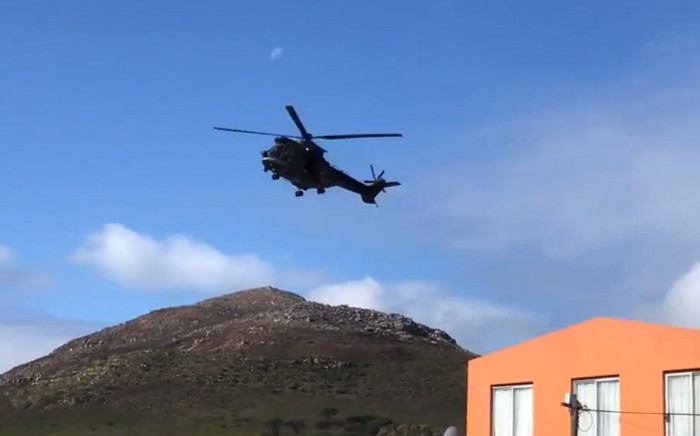 An SANDF helicopter carrying police officers was dispatched to Ocean View to assist with the violence that escalated between police and protesters on 8 August 2019. Picture: Kevin Brandt/EWN.