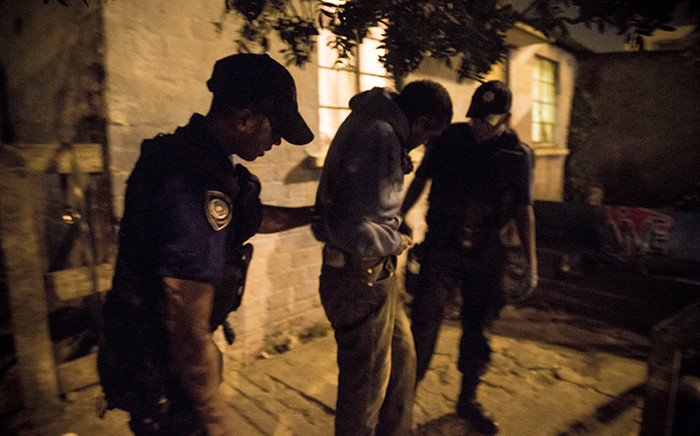 Members of Cape Town's gang and drug task force arrest a man caught with drugs in Manenberg. Picture: Thomas Holder/EWN.