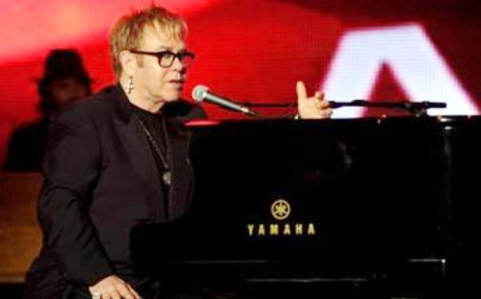 Elton John performs on stage at the 2010 MusiCares Person of the Year Tribute to Neil Young at the Los Angeles Convention Centre. Picture: AFP