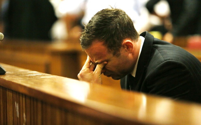 Paralympian Oscar Pistorius reacts as judgment is being handed down in his murder trial at the High Court in Pretoria on Friday, 12 September 2014. Picture: Pool.