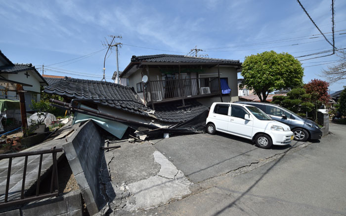 A general view shows a damaged house in Mashiki, Kumamoto prefecture on April 15, 2016, after a 6.5-magnitude quake struck the southwestern island of Kyushu on April 14. Rescuers searched through rubble for possible survivors on April 15 after a powerful earthquake in southern Japan left at least nine people dead and hundreds injured, though officials said the toll was unlikely to rise dramatically. Picture: AFP.