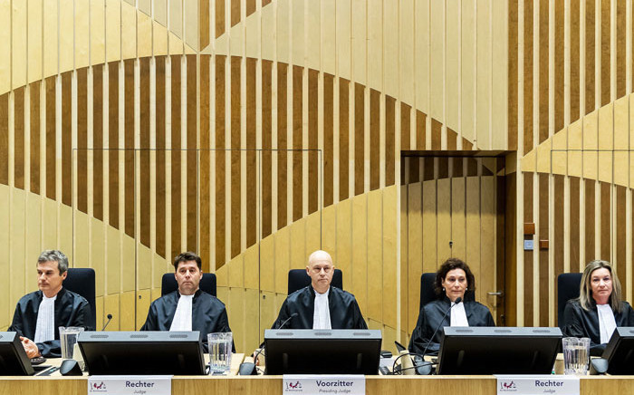 Magistrates wait, on 9 March 2020 in Schiphol, before the opening of the trial of four men accused of murder over the downing of Malaysia Airlines flight MH17 in 2014, even though the suspects are still at large. Picture: AFP