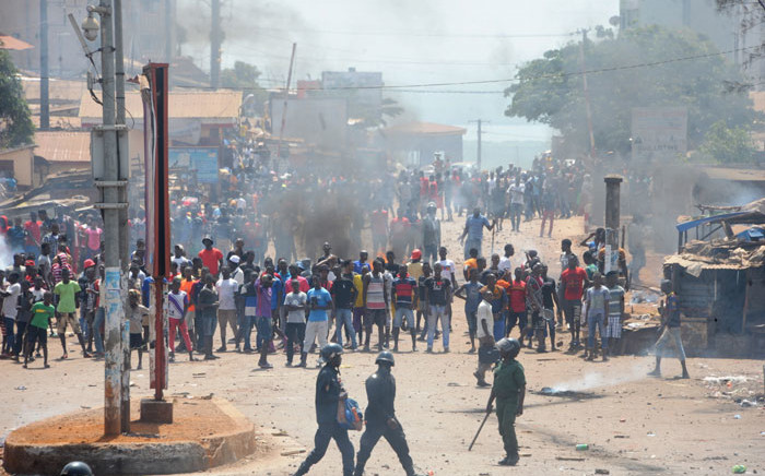 FILE: Protesters clash with anti-riot police in a street in Conakry, Guinea on 13 March 13, 2018 during a demonstration against President Alpha Conde. Picture: AFP