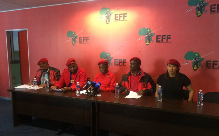 EFF leader Julius Malema and party members address the media in Braamfontein. Picture: Masa Kekana/EWN.