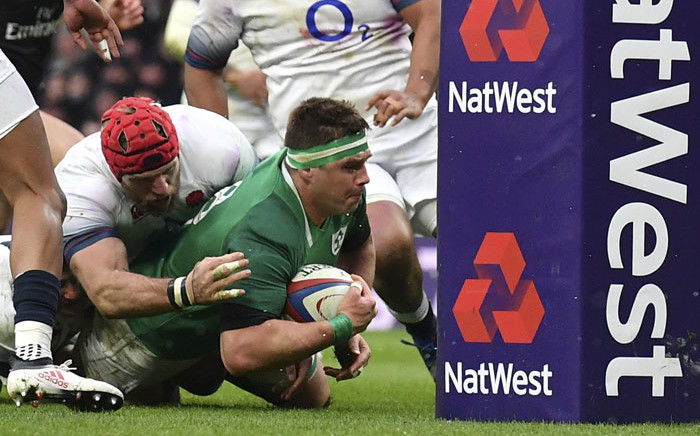 FILE: Ireland's number 8 CJ Stander (R) grounds the ball at the base of the post to score their second try during the Six Nations international rugby union match between England and Ireland at the Twickenham, west London, on 17 March 2018. Picture: AFP