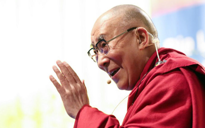 Tibetan spiritual leader Dalai Lama gives a lecture on 23 August, 2014 in Hamburg. Picture: AFP.
