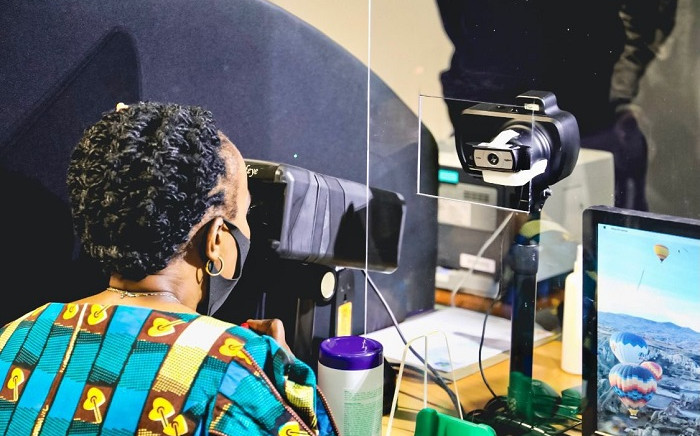 Deputy Transport Minister Sindisiwe Chikunga gets her eye test done at a driver's licence testing centre. Picture: Fikile Mbalula/Twitter.